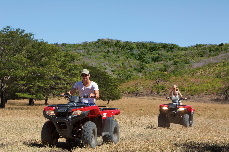 Couple riding ATVs