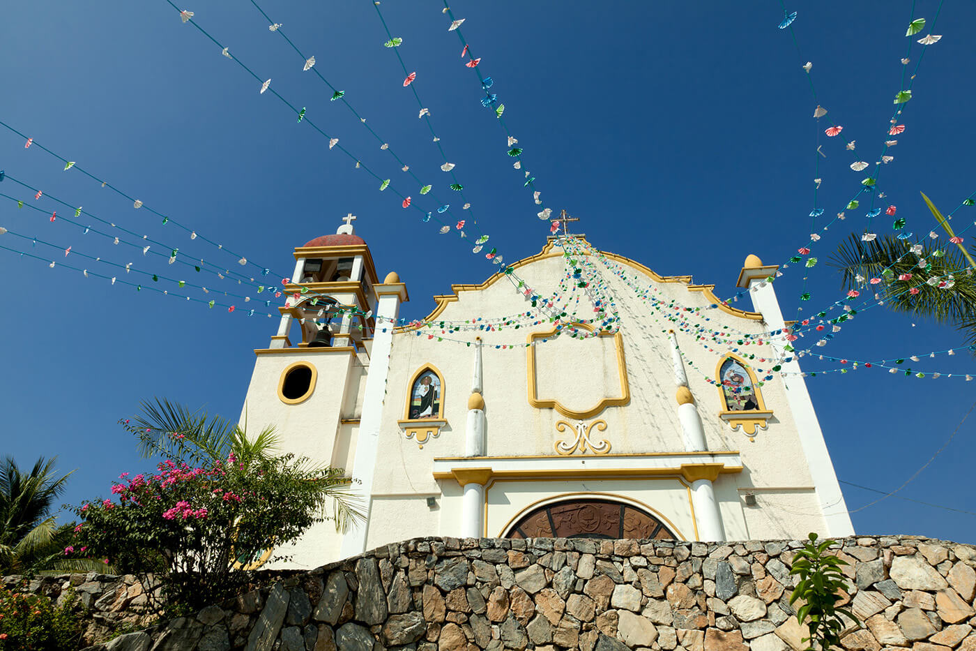 Colorful church in downtown Huatulco