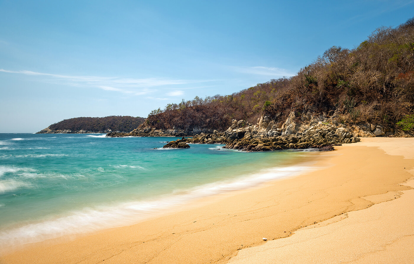Huatulco private bay with golden sand