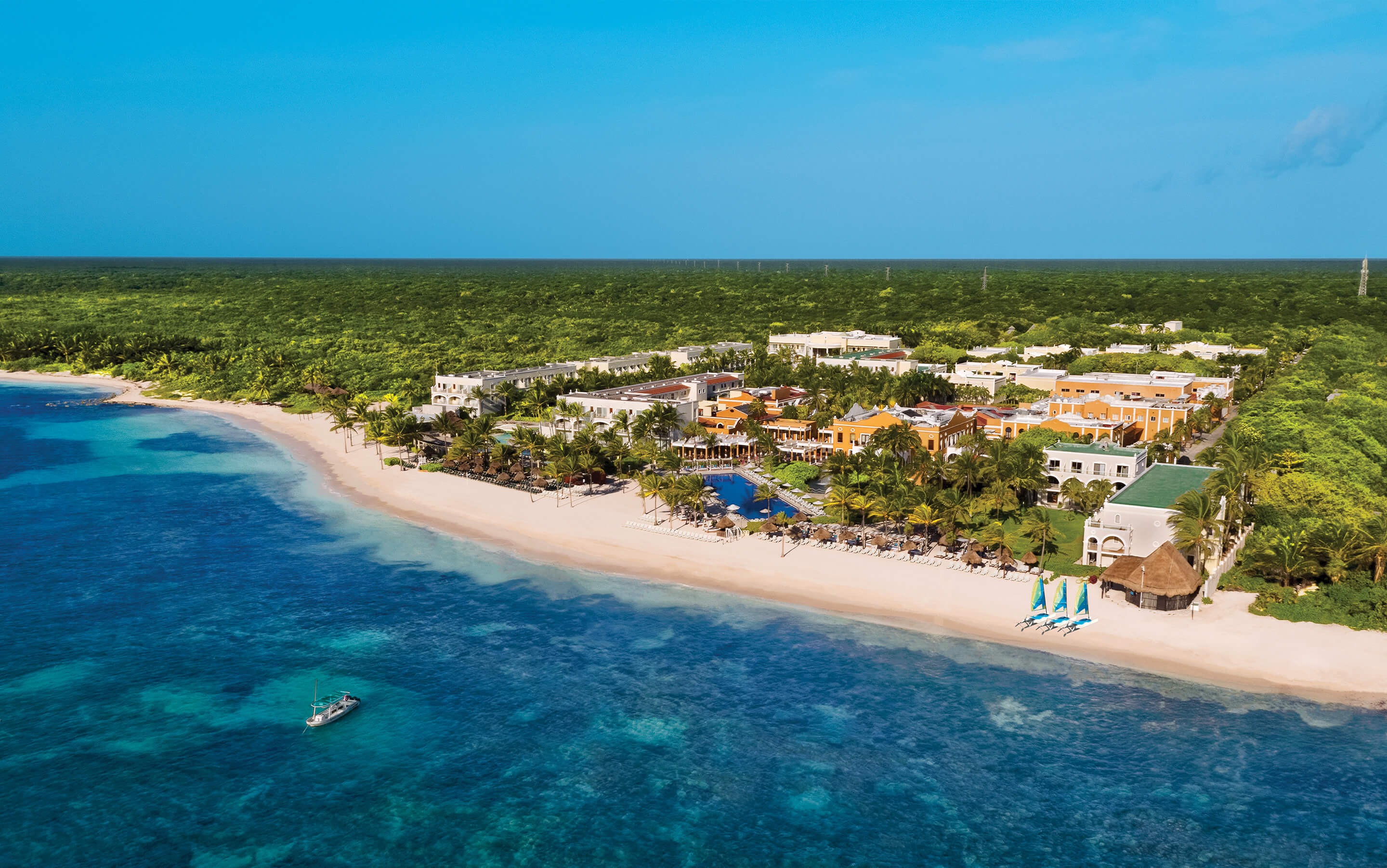 EAerial daytime view of Dreams Tulum Resort and Spa beachfront views and lush gardens