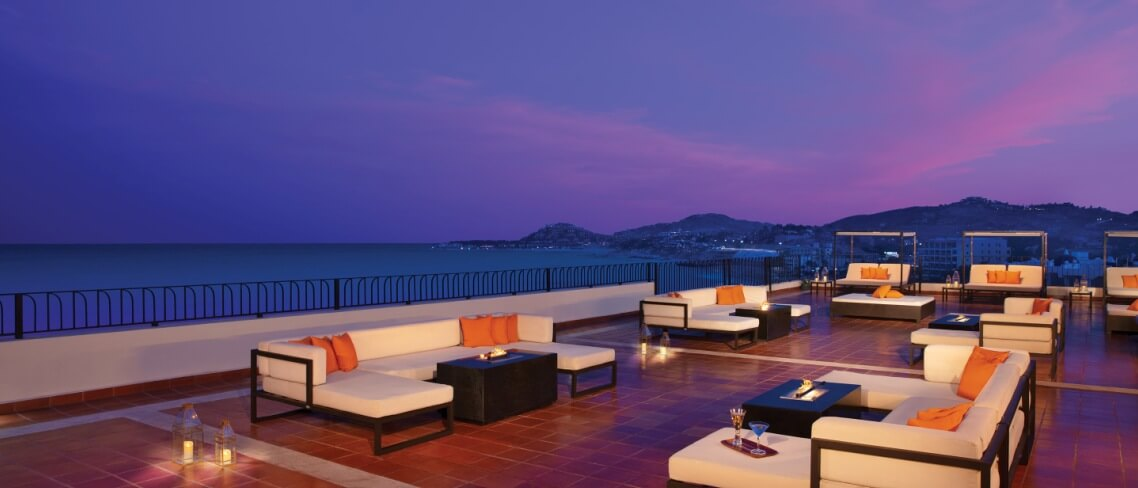rooftop bar and lounge at dusk