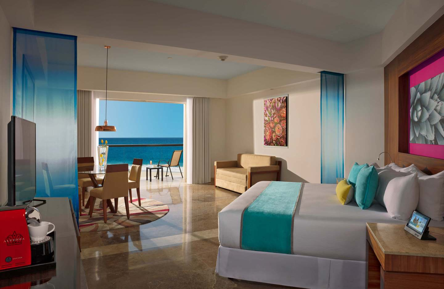 hotel room with king bed, dining table and balcony