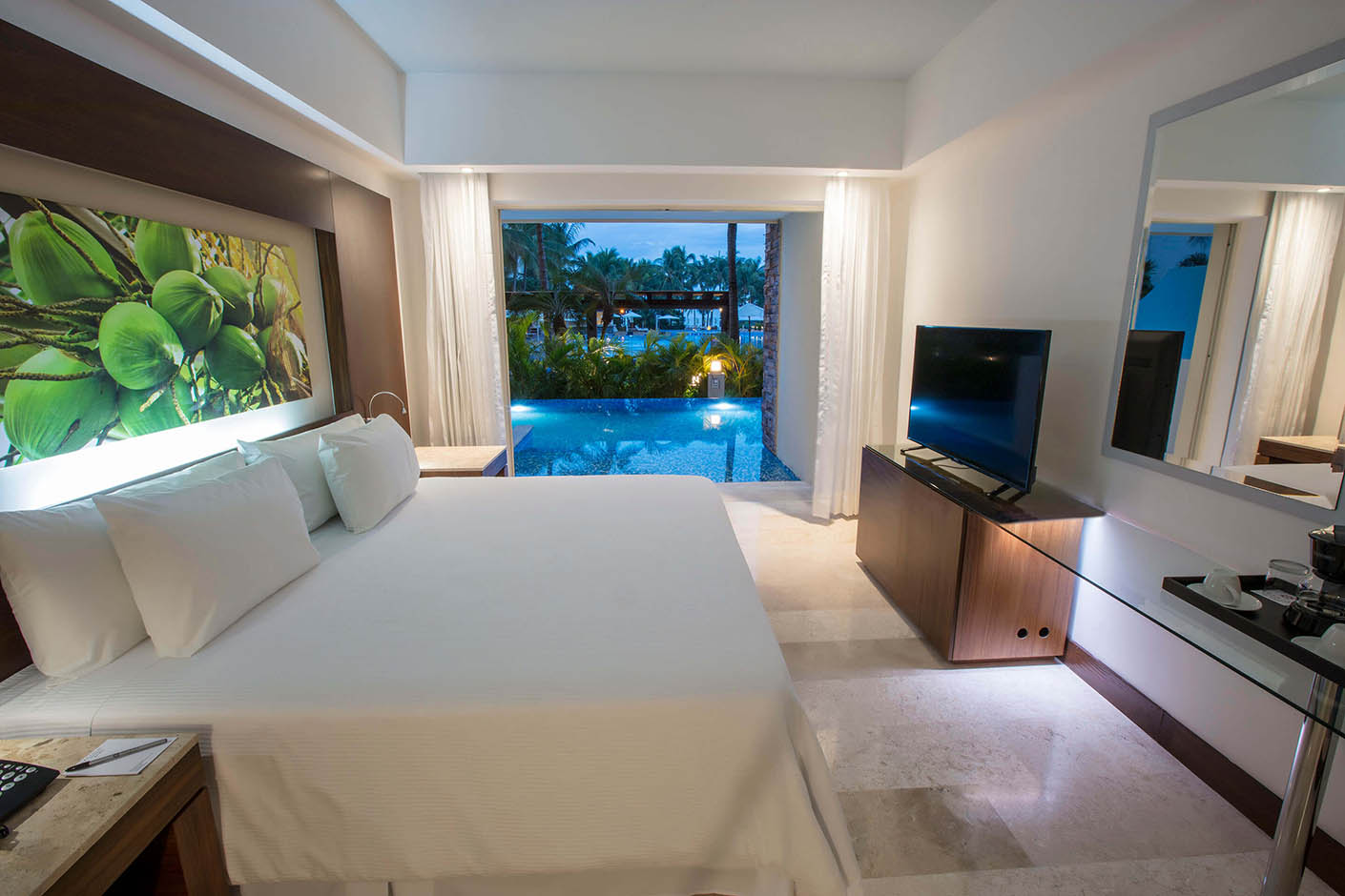 pool outside of hotel room with king bed