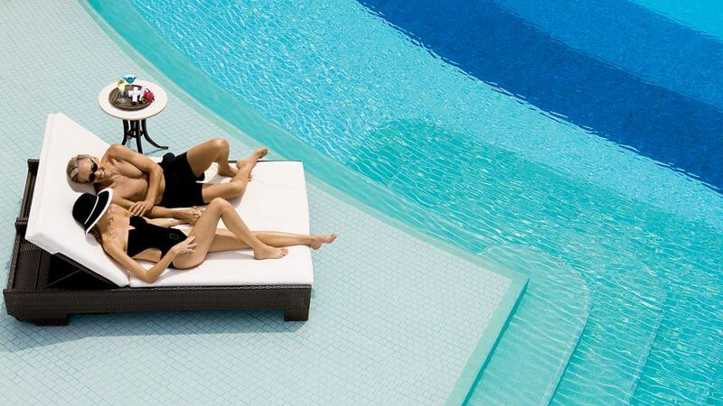 couple relaxing by the pool