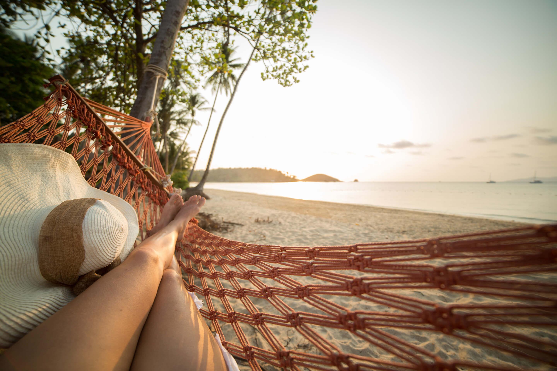 girl on hammock near the ocean