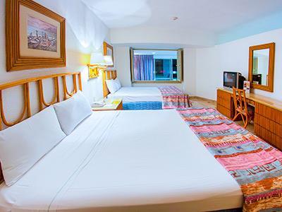 Playa suites acapulco hotel en acapulco zona dorada for Hoteles con habitaciones comunicadas playa