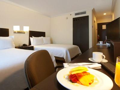 Deluxe Room Vista Piscina 2 camas Matrimoniales
