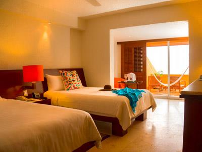 Deluxe Room y Brisas Beach Club