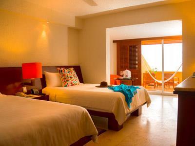 Deluxe Room y Brisas Beach Club