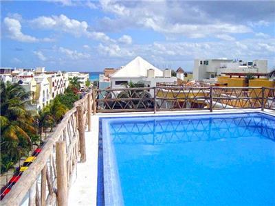 Fotograf as del hotel las palmas condominios for Piscina las palmas