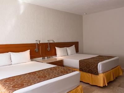 Habitación Estándar 2 camas Matrimoniales